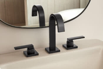 The Speakman Lura faucets feature a sleek spout paired with three different handle styles, one cross handle and two lever handle options.